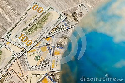 The global map is a sign of many banknotes and bills of various states globally in US dollars
