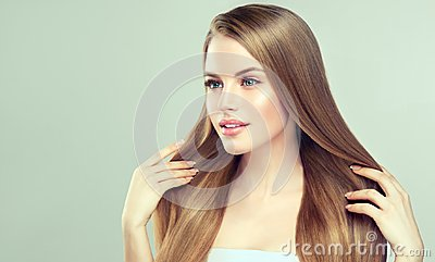 Portrait of young woman with straight, loose hairstyle on the head. Hairdressingand beauty technologies.
