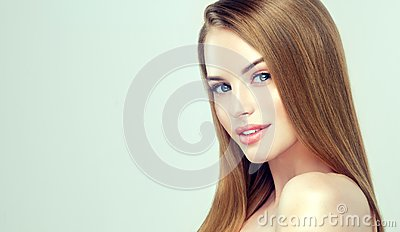 Young pretty model with straight, loose hairstyle on the head.Hairdressing, cosmetology, and beauty technologies.
