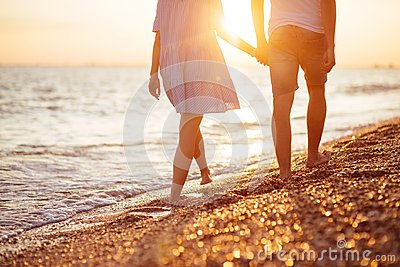 Young happy couple on seashore.