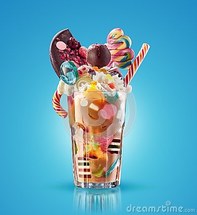 Monster shake, freak caramel shake isolated. Colourful, festive milk shake cocktail with sweets, jelly. Colored caramel