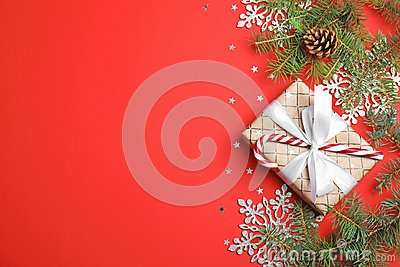 Christmas composition with gift box and festive decor on color background