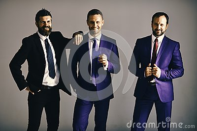 Executives advertise company and partnership on light grey background. Businessmen wear smart suits and ties. Business