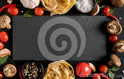 Fettuccine tagliatelle paste with herbs and spices with slate bo
