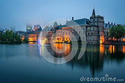 The Binnenhof palace in a foggy evening in Hague, Netherlands