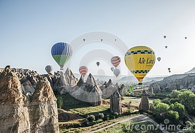 colorful hot air balloons flying in sky above majestic rock formations in famous cappadocia, turkey ВВВ