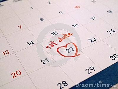 Red first Date marked on white calendar agenda target date for romance and dating