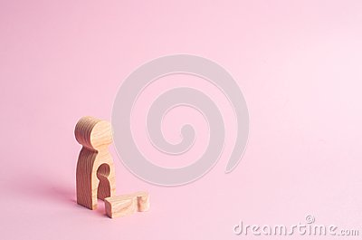 A wooden figure of a woman with a void from which a child fell. The concept of the loss of a child, abortion of pregnancy