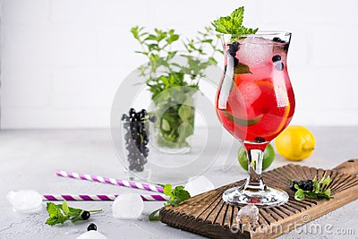 Summer cold drink with blueberry, mint lemon and ice