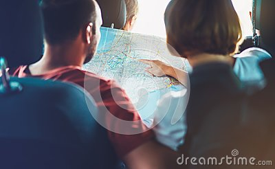 Two tourist traveler together hold in hands europe cartography, view and plan tourist way road, trip in transportation, couple hip