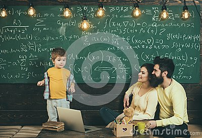 Home schooling. Home schooling pupil at chalkboard. Home schooling education with parents. Family choose home schooling
