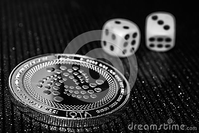 Coin cryptocurrency iota and rolling dice.