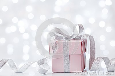 Present or gift box against bokeh background. Holiday greeting card on Birthday or Christmas.