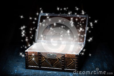 Wooden coffer with white sparkling lights