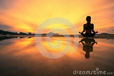 Young woman practicing yoga in the nature, Female happiness, Silhouette of young woman practicing yoga on the beach at sunset