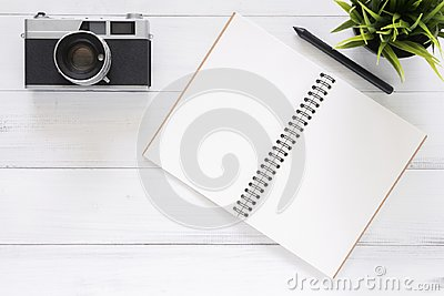 Creative flat lay photo of workspace desk. White office desk wooden table background with mock up notebooks and retro camera.