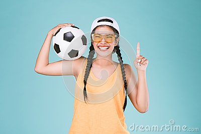 Sport woman fan holding a soccer ball,celebrating point one finger up winner sign