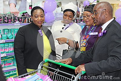 KwaZulu Natal Premier with top women MECs and his first lady buying sanitary pads to help keep poor girls in school
