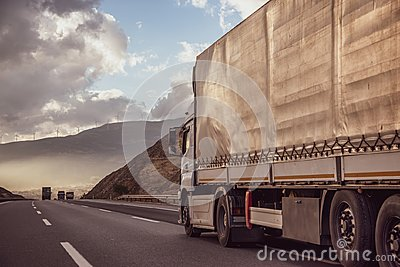 stock image of truck on the road in a rural landscape at sunset.. logistics transportation and cargo freight transport.