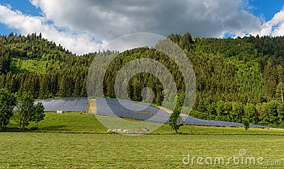 Solar panel power system in a countryside by the forest
