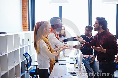 African and Hindu coworkers with their supporters arguing at work