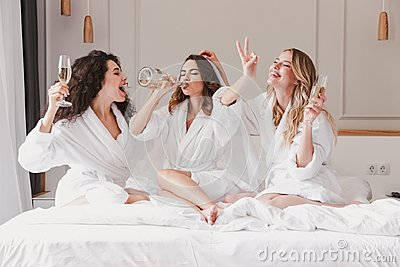 Three european young women 20s having fun at hen party and drink