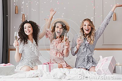 Luxury bachelorette party in posh apartment while happy young th