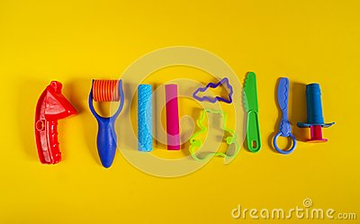 stock image of tools for creative hobbies. molding of plasticine, stack, shape, rolling pin.