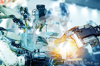 stock image of iot smart factory , industry 4.0 technology concept, robot arm in automation factory background with fake sunlight on operation li
