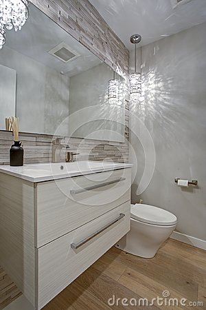 Contemporary bathroom design with taupe linear tiles accent wall