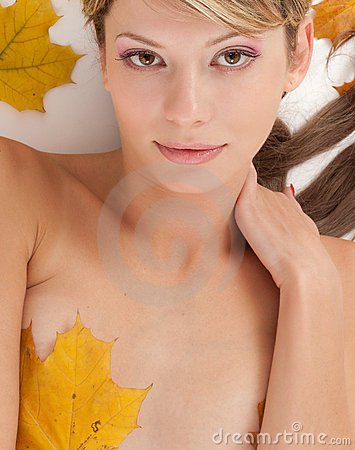 Attractive nudity woman covering by maple leafs
