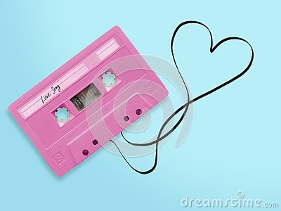 Pink audio cassette tape with label tag love song tangled tape