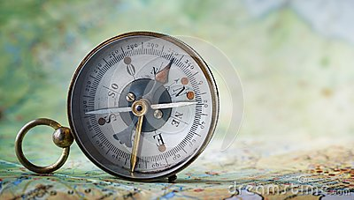 Magnetic compass on world map.Travel, geography, navigation, tou