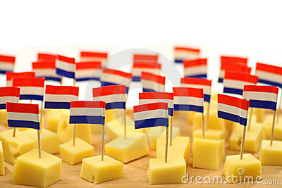 Blocks of Dutch cheese on a wooden tray