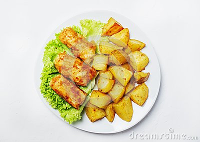 Fish and chips on a plate, white background, top view