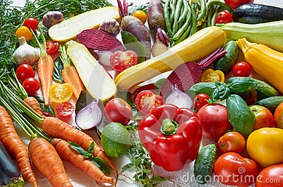 stock image of healthy vegetarian diet food background. various fresh organic vegetables on the white table: tomatoes, sliced zucchini, beet