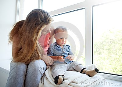 Mother educate baby son at home, parenting relationship