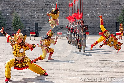 Teamwork at traditional dance, cultural performance of warriors, China