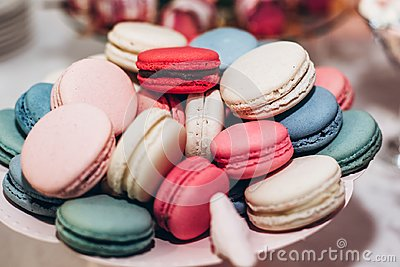 stock image of delicious macaroons close-up. candy bar at luxury wedding reception. exclusive expensive catering. table with modern desserts. sp