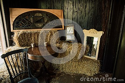 Western Room With Hay Bales And Clocks