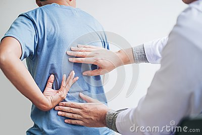 Doctor consulting with patient Back problems Physical therapy co
