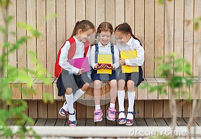 Happy children girlfriends schoolgirls student elementary schoo