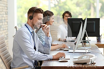 Technical support operators with headsets