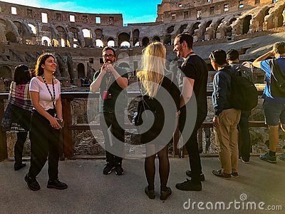 Tour guides and tourists at the Colosseum, Rome, Italy