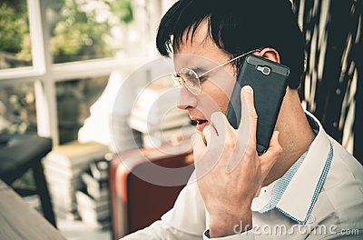 Serious Business man making call on his mobile phone
