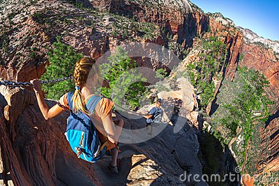 Hikers walk on the steep and dangerous trail named Angels Landin