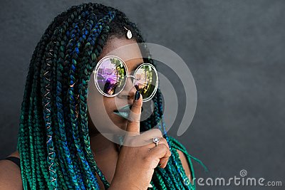 African American Woman with Beautiful Teal Green Blue Braids