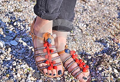 Bohemian sandals advertisement on the beach - greek leather sandals