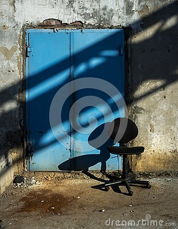 A table and a door. Industrial scene.