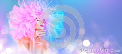Fashion model woman in colorful bright lights posing, portrait of beautiful girl with trendy makeup and colorful pink hairdo
